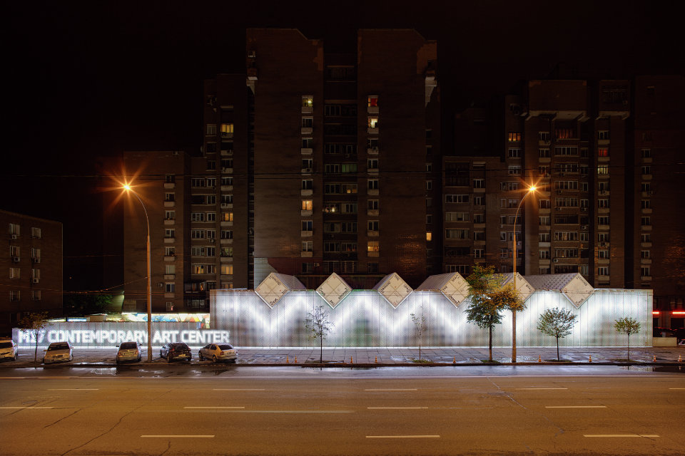 parametric facade with galvanized perforated panels at night