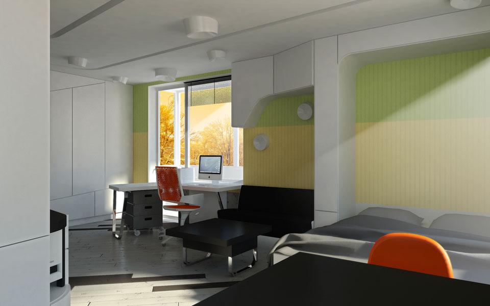 рабочее место и кровать в квартире-студии